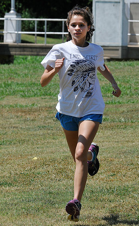 Enid High cross country runner, Alexandria Hernendez, begins practice Tuesday August 16, 2016 on the NOC Enid campus. (Billy Hefton / Enid News & Eagle)