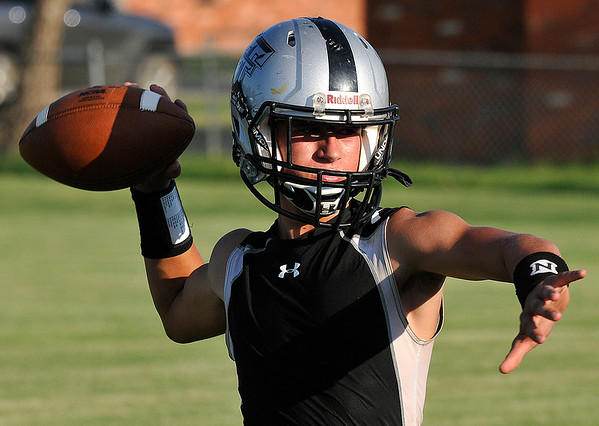 Timberlake's Joey Najera throws a pass during practice August 11, 2016 at Timberlake High School. (Billy Hefton / Enid News & Eagle)