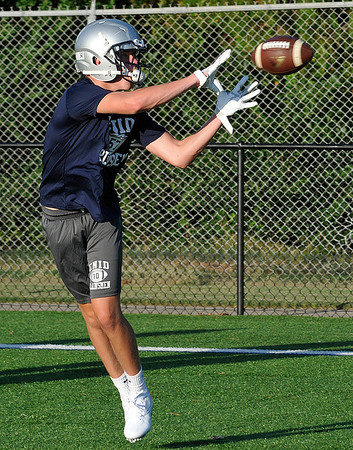 Price Dillingham catches a pass during the first day of practice Monday August 8, 2016 at D. Bruce Selby Stadium. (Billy Hefton / Enid News & Eagle)