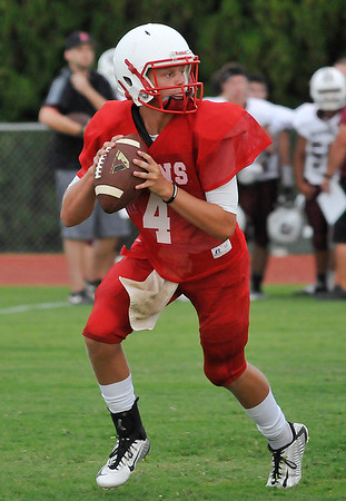 Chisholm's Braden Meek looks for a receiver against Blackwell during a scrimmage Friday August 19, 2016 at Chisholm High School. (Billy Hefton / Enid News & Eagle)