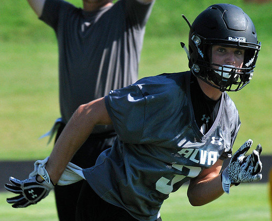 Alva's Austin Shklar runs down a receiver during a 7 on 7 drill Wednesday August 10, 2016 at Alva High School. (Billy Hefton / Enid News & Eagle)