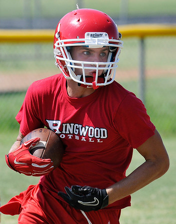 Ringwood's Zach Bromlow runs the ball during practice August 11, 2016 at Ringwood High School. (Billy Hefton / Enid News & Eagle)