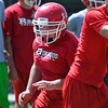 Ringwood's Chris Sanders looks for someone to block as he pulls around th end during practice August 11, 2016 at Ringwood High School. (Billy Hefton / Enid News & Eagle)