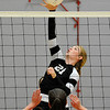 OBA's Elizabeth Price hits the ball against Chisholm's Kelsie Dent Tuesday August 23, 2016 at Chisholm Middle School. (Billy Hefton / Enid News & Eagle)