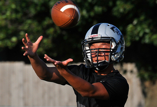 Timberlake's Braden Frech catches a pass during practice August 11, 2016 at Timberlake High School. (Billy Hefton / Enid News & Eagle)