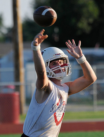 Cherokee's Jarrett James throws a pass during practice Wednesday August 10, 2016 at Cherokee High School. (Billy Hefton / Enid News & Eagle)