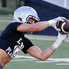 Colton Troxell catches a pass during the first day of practice Monday August 8, 2016 at D. Bruce Selby Stadium. (Billy Hefton / Enid News & Eagle)