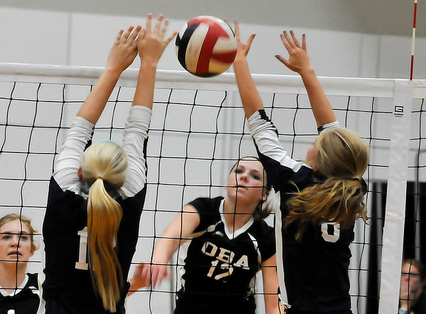 OBA's Katie Friesen hits the ball between Enid's Heather Wilkinson and Molly Bloom Thursday August 18, 2016 at Oklahoma Bible Academy. (Billy Hefton / Enid News & Eagle)