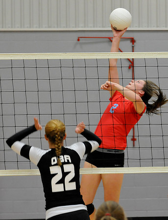 Chisholm's Kaylee Petersen hits the ball against OBA's Sage Kroeker Tuesday August 23, 2016 at Chisholm Middle School. (Billy Hefton / Enid News & Eagle)