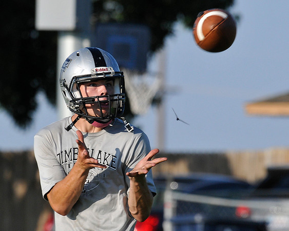 Timberlake's Dylan Syler catches a pass during practice August 11, 2016 at Timberlake High School. (Billy Hefton / Enid News & Eagle)