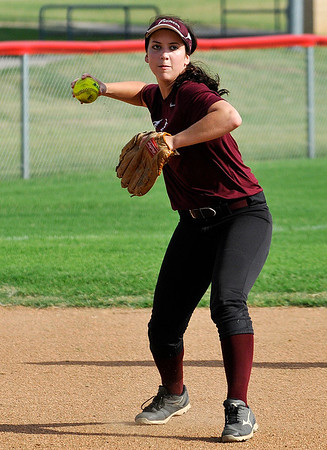 Pioneer's Rylie Schneider makes a throw to first during a scrimmage at Chisholm High School Wednesday AUgust 3, 2016. (Billy Hefton / Enid News & Eagle)