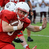 Chisholm's Connor Pasby runs the ball against Blackwell during a scrimmage Friday August 19, 2016 at Chisholm High School. (Billy Hefton / Enid News & Eagle)