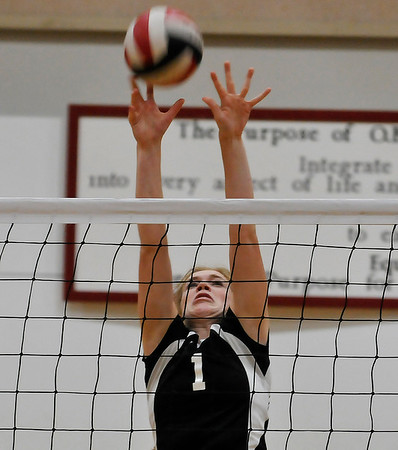 OBA's Elizabeth Price attempts to block a shot against Enid Thursday August 18, 2016 at Oklahoma Bible Academy. (Billy Hefton / Enid News & Eagle)