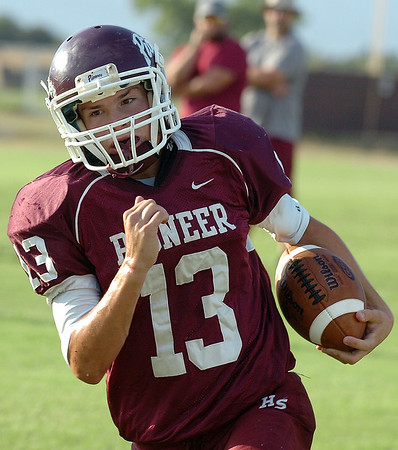 Pioneer's Chris Faw Faw runs the ball against Covington-Douglas during a scrimmage Thursday August 25, 2016 at Pioneer High School. (Billy Hefton / Enid News & Eagle)