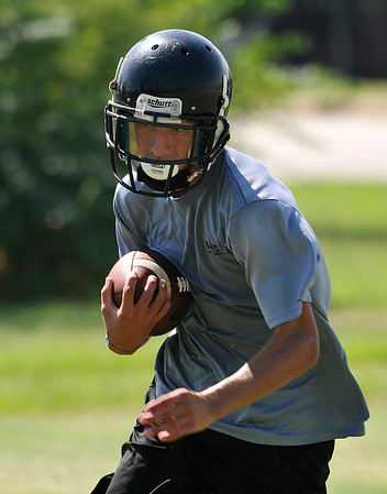 Pond Creek-Hunter's Brandon Gibson runs through drills during preseason practice Tuesday August 9, 2016. (Billy Hefton / Enid News & Eagle)