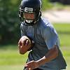 Pond Creek-Hunter's Brandon Gibson runs through drills during preseason practice Tuesday August 9, 2016. (Billy Hefton / Enid News & Eagle)