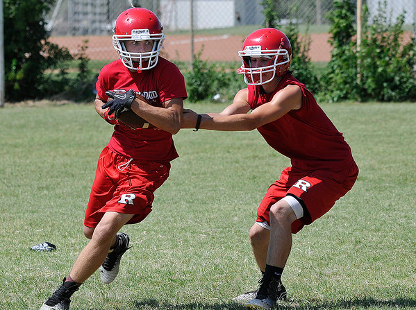 Ringwood's Zach Bromlow takes a handoff from Jase Adkinson during practice August 11, 2016 at Ringwood High School. (Billy Hefton / Enid News & Eagle)