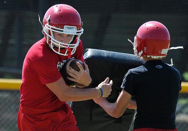 Ringwood's Garrett Ools runs the ball during practice August 11, 2016 at Ringwood High School. (Billy Hefton / Enid News & Eagle)