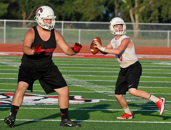 Cherokee's Garret Padilla pass blocks as Jarrett James throws a pass during practice Wednesday August 10, 2016 at Cherokee High School. (Billy Hefton / Enid News & Eagle)