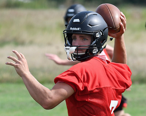OBA's Jud Minx throws a pass during the first day of practice Monday August 7, 2017 at D. Bruce Selby Stadium. (Billy Hefton / Enid News & Eagle)
