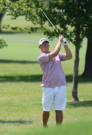 David Turner watches his shot onto the 9th green during the Wheat Capital Tournament Saturday August 5, 2017 at Meadowlake Golf Course. (Billy Hefton / Enid News & Eagle)