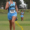 Enid cross country runner, Kinley Davis, crosses the finish line in second place during the Enid Invitational Tuesday August 15, 2017. (Billy Hefton / Enid News & Eagle)