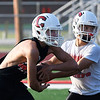 Cherokee's Dakota Dooley runs the option with Payton Ream during practice Thursday August 10, 2017 at Cherokee High School. (Billy Hefton / Enid News & Eagle)
