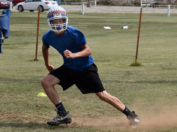 Matt Buck of Waukomis runs through conditioning drill during practice at Waukomis High School Tuesday August 8, 2017. (Billy Hefton / Enid News & Eagle)