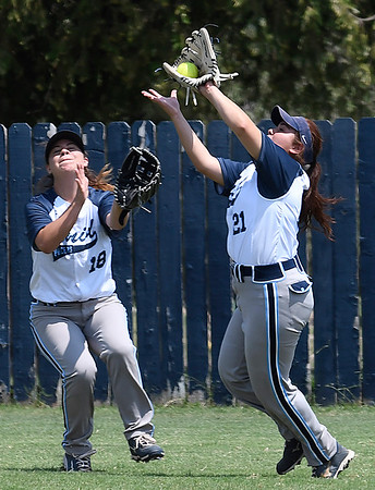 Enid's Ruth Ramirez catches a fly ball in front of Haylee Schwandt against Bartlesville Tuesday August 8, 2017 at Pacer Field. (Billy Hefton / Enid News & Eagle)