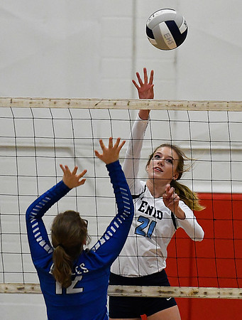 Enid's Emily Peterson hits the ball against Hennessey Tuesday August 15, 2017 at the NOC Mabee Center. (Billy Hefton / Enid News & Eagle)