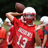 Chisholm's Braden Meek throws a pass during the first day of practice at Chisholm High School Monday August 7, 2017. (Billy Hefton / Enid News & Eagle)