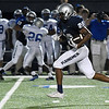Enid's Marlo Hughes breaks free for a long touchdown run against Guthrie Friday August 25, 2017 at D. Bruce Selby Stadium. (Billy Hefton / Enid News & Eagle)