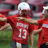 Chisholm's Braden Meek talks with head coach, Joey Reinhart, during the first day of practice at Chisholm High School Monday August 7, 2017. (Billy Hefton / Enid News & Eagle)
