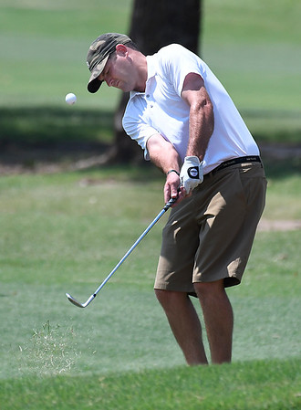 Heath Myers chips onto the 9th green during the Wheat Capital Tournament Saturday August 5, 2017 at Meadowlake Golf Course. (Billy Hefton / Enid News & Eagle)