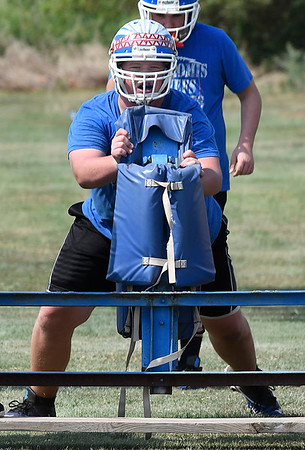Evan Carter of Waukomis works with the blocking sled during practice at Waukomis High School Tuesday August 8, 2017. (Billy Hefton / Enid News & Eagle)