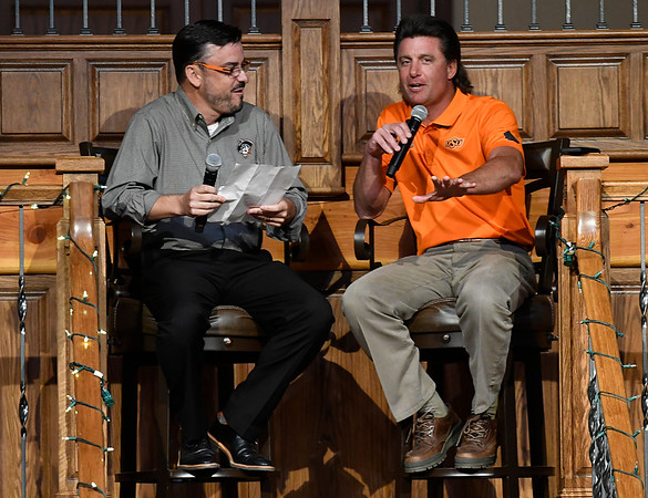 Oklahoma State head football coach, Mike Gundy, smiles as he answers a question from Larry Reece during the Cowboy Caravan stop in Enid at 81 Ranch Thursday August 10, 2017. (Billy Hefton / Enid News & Eagle)