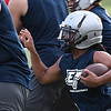Jaden Dimarcut runs the ball during the first day of practice Monday August 7, 2017 at D. Bruce Selby Stadium. (Billy Hefton / Enid News & Eagle)