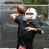 Angel Gonzales throws a pass during the first day of practice Monday August 7, 2017 at medford High School. (Billy Hefton / Enid News & Eagle)