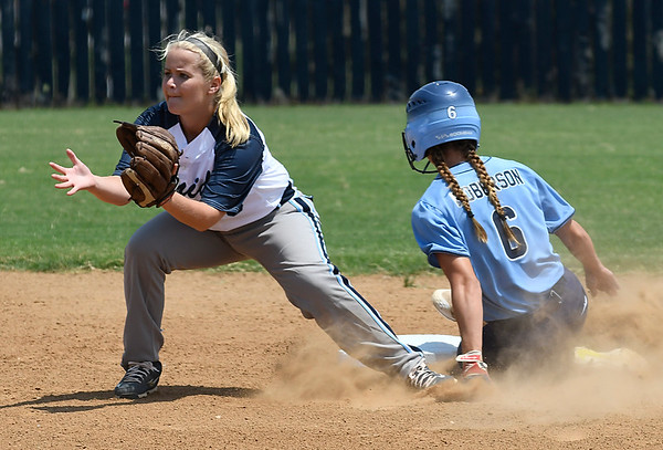 Enid's Lauren Black waits on the ball as Bartlesville's Shelbie Roberson slides into second Tuesday August 8, 2017 at Pacer Field. (Billy Hefton / Enid News & Eagle)