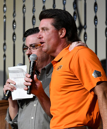 Oklahoma State head football coach, Mike Gundy, with Larry Reece during the Cowboy Caravan stop in Enid at 81 Ranch Thursday August 10, 2017. (Billy Hefton / Enid News & Eagle)