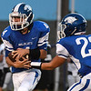 Gavin Smith of Covington-Douglas hands off to Tristen Griffin during the opening game of the season against Timberlake at Covington-Douglas High School AUgust 24, 2017. (Billy Hefton / Enid News & Eagle)