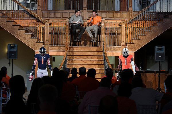 Oklahoma State head football coach, Mike Gundy, sits with Larry Reece during the Cowboy Caravan stop in Enid at 81 Ranch Thursday August 10, 2017. (Billy Hefton / Enid News & Eagle)