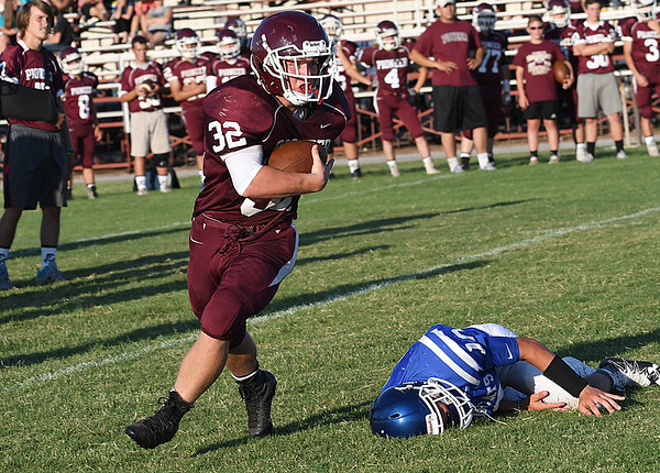 Pioneer's River Pickering gets by a Covington-Douglas defender during a scrimmage August 18, 2017 at Pioneer High School. (Billy Hefton / Enid News & Eagle)