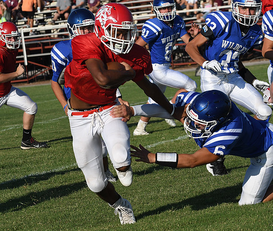 Kremlin-Hillsdale's Elijah Norwood runs the ball against Covington-Douglas during a scrimmage August 18, 2017 at Pioneer High School. (Billy Hefton / Enid News & Eagle)