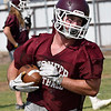 Pioneer's Cody McVey turns upfield after catching a pass during practice at Pioneer High School Tuesday August 8, 2017. (Billy Hefton / Enid News & Eagle)
