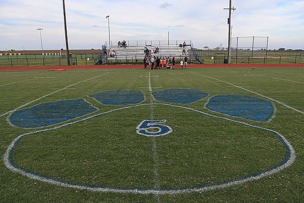 The number 5 painted at midfield in honor of Covington-Douglas football player, Trevor Navratil, August 24, 2017. (Billy Hefton / Enid News & Eagle)