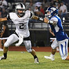 Timberlake's Joey Najera gets away from the rush of Braden Davis of Covington-Douglas during the opening game of the season at Covington-Douglas High School AUgust 24, 2017. (Billy Hefton / Enid News & Eagle)