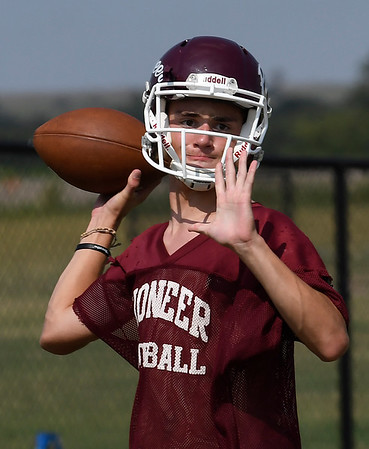 Pioneer's Garrett Mason throws a pass during practice at Pioneer High School Tuesday August 8, 2017. (Billy Hefton / Enid News & Eagle)