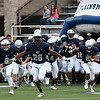 Enid's Marlo Hughes (26) leads the Plainsmen onto the field against Guthrie August 25, 2017 at D. Bruce Selby Stadium. (Billy Hefton / Enid News & Eagle)