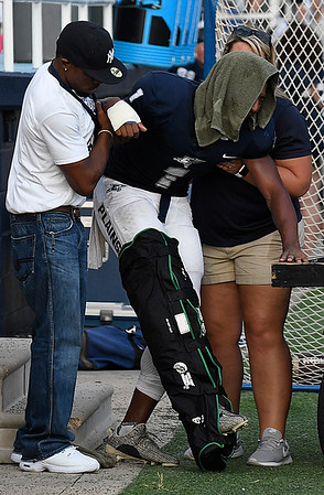 Enid's Will Phillips is helped to a cart after injuring his leg during the first quarter against Guthrie Friday August 25, 2017 at D. Bruce Selby Stadium. (Billy Hefton / Enid News & Eagle)